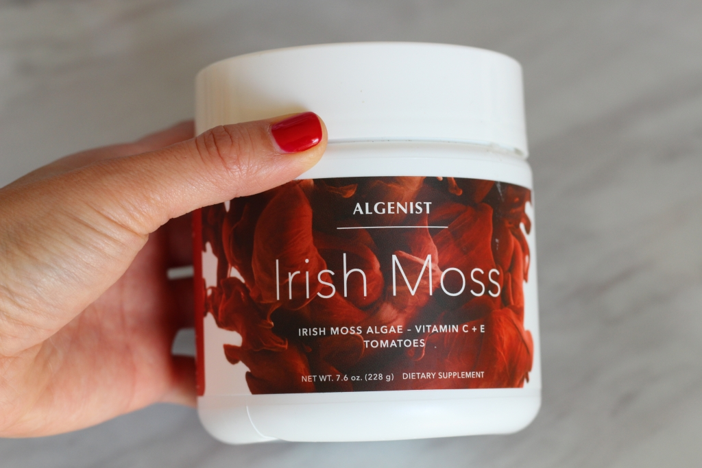 Blogger holding Algenist's Irish Moss supplement bottle.